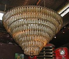 Coke bottle chandelier bottle art pinterest bottle chandelier extremely cool coke bottle chandelier aloadofball Images