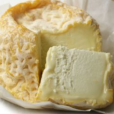 Langres has an orange colored rind (produced by annatto coloring) and a creamy, pale yellow interior. A bit salty, Langres is a complex and supple cheese that melts in the mouth.