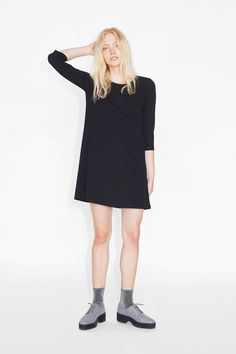 Dress it up or dress it down, this textured shift dress is the kind of dress you'll be pulling out of the wardrobe time and time again. colour: black magic  In a size small the chest width is 90 cm and the length is 84 cm. The model is 178 cm and is wearing a size small.
