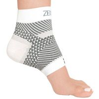 Zensah Plantar Fasciitis Foot Sleeve: Relieve pain from plantar fasciitis with this compression sleeve from Zensah. Targeted T-band compression lifts and stabilizes your foot from the achilles to plantar fascia. 3-D Geo Technology provides pin-point compression to relieve arch and heel pain. Made with silver ions to reduce odor and bacteria.
