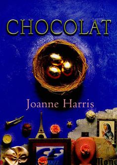 Chocolat by Joanne Harris. Vianne Rocher moves to a French village and opens a chocolate boutique at the beginning of Lent! The local priest is outraged and the ensuing controversy escalates into a 'church not chocolate' battle.