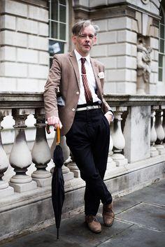 Robert J Railton, wears Sparks trousers, Topman shoes, belt and blazer, H&M shirt, Zara tie, and carries a Fulton umbrella. © Joseph Kent / www.unlimitedbyjk.com