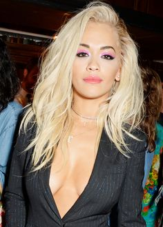 Rita Ora proves to be a total bad-ass with an electric pink double cat-eye and tousled blond waves