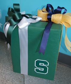 Wedding gift card box. Groom went to Michigan, Bride went to Michigan State. Other side of box is decorated with Michigan Maize and Blue. Lisa's Gift Wrappers