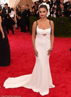 Looking lovely: Selena Gomez stunned in a white Vera Wang gown as she attended the 2015 Met Gala in New York City on Monday