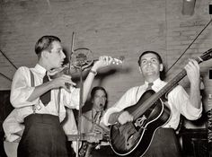 """October 1938. """"Cajun musicians at fais-do-do at National Rice Festival (video). Crowley, Louisiana."""" View full size. Medium format negative by Russell Lee."""