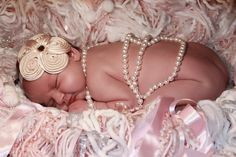 Cute and easy idea: fringed blanket- furry white yarns fleece, pom poms, pearls ribbons - for a textured background of baby girl photos.