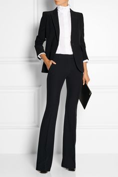 What To Wear: This outfit is simple. The blazer is a great fit for her frame and body type. It's fitted, making her look put together and not too relaxed or informal. The shirt has a modest, high neckline and the purse is not over the top. It is a nice addition, a complement, but not a scene stealer.