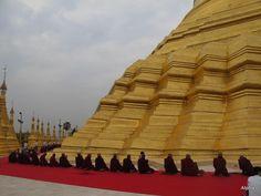 Congregation of the Bhikkhu Sangha at Shwedagon Paya, Yangon, Myanmar.  Source: unknown.