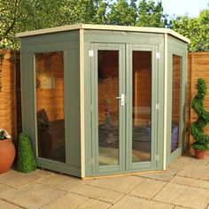 Who likes the painted version of our popular 7 x 7 Waltons Premier Corner Summerhouse? We love it! #summerhouse #gardenroom #inspiration #garden