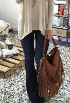 Flared jeans and an over sized sweater make for a perfect fall outfit!