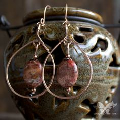 "Lovely rosy-pink jasper stones, dangle from handmade copper teardrop shapes.  The earrings are just over 3"" long, and are very dramatic, while still being suitable for casual day-time wear.  Handmade copper earwires -- a great solution for nickel sensitive ears!"