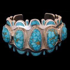 Navajo Waterweb Kingman Turquoise Bracelet by Vern Haskie. Displaying seven extremely large and well matched cabochons and 30 inlaid zones of high grade, natural water web Kingman turquoise, this bracelet is easy to amazing.
