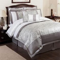 Eight-piece zebra-print comforter set. Product: Full: 1 Comforter, 1 bed skirt, 2 euro shams, 2 standard shams and 2 dec...