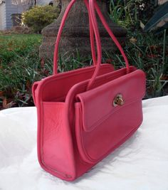 Nearly 50 years old! Designed by Bonnie Cashin, Coachs first purse designer, around 1968. Made in one of her signature colors, vermillion,