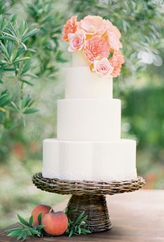 Brides: White Cake with Peach Roses & Zinnias. Simple four-tier white wedding cake topped with peach roses and zinnias,  by Sweet & Saucy.