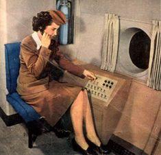 flight attendant using intercom in flight
