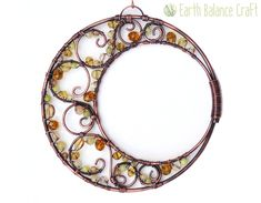 Moonlight Sun Catcher - Inspired by the soft light cast by the crescent moon at night, this hanging decoration features a muted palette of yellow and cream gemstones and glass.