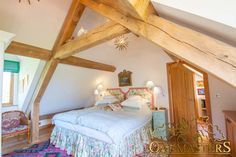 In this small Kentish home, exposed oak roof trusses have been elevated from the ground to ad extra head room.