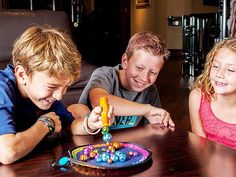 This magnetic bells game, discovered by The Grommet, tasks you with picking up all the bells of one color with a magnetic wand.
