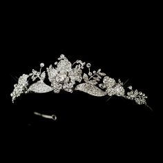 """You will dazzle in this exquisite headpiece!! A beautiful bridal Tiaraof sparkling rhinestones encrusted into floral and leaves design, with a touch of Swarovski crystals on silver plating. This is no doubt an eye-catching headpiece.  1.5"""" x 8.5"""" (Design) X 15.5"""" (Band)."""