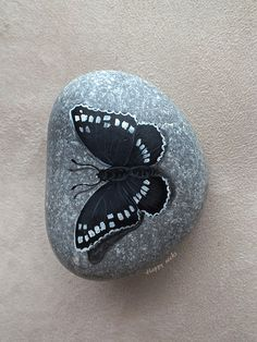 painted rock == So perfectly rendered, it looks as if the butterfly's wing is lifted away from the rock. To really look so real, so 3d, takes a lot of skill.