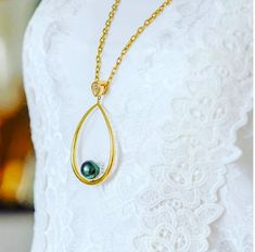 Drop pearl pendant in perfect shades of green and gold.    #culturedpearls #pearl #necklace #green #gold