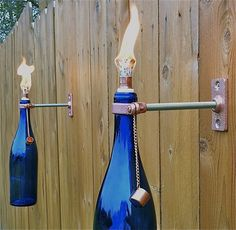 Items similar to 4 Cobalt Blue Wine Bottle Tiki Torches - Outdoor Lighting - Gift for Dad - Outdoor Spring Decor - Hurricane Lamp - Backyard lighting on Etsy Wine Bottle Tiki Torch, Wine Bottle Crafts, Wine Bottles, Diy Bottle, Wine Bottle Fountain, Patron Bottles, Wine Bottle Garden, Bottle Wall, Empty Bottles