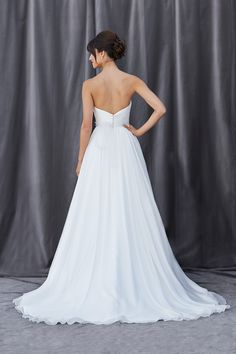 Your Dream Bridal // Lis Simon - Strapless sweetheart neckline with a pleated bodice ending at the natural waistline. Full A-line skirt that gathers at the waist. Zipper back accompanied with fabric buttons. http:www.yourdreambridal.com