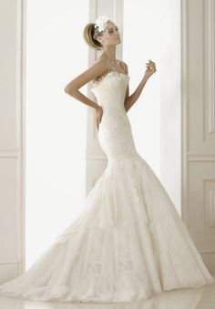 Pronovias 2015 Bridal Collections - Part 2 - Belle The Magazine Strapless fears shaped neckline fit and flare wedding dress with lace and corset details