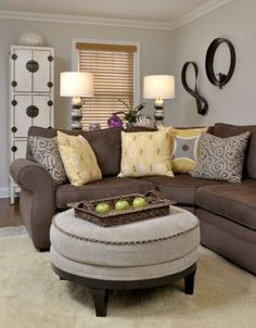 Brown sofa and griege walls. But in our accent colors instead. Other wall decor but gives idea with wall and couch colors together