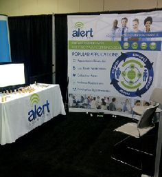 "Phil Young with Alert Solutions shared their story: ""We use the table cover at all of our tradeshow events. We attend over 25 per year! It's a great way to draw attention and reinforce our brand."""