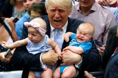 Republican presidential candidate Donald Trump holds Kellen Campbell of Denver, right, and Evelyn Keane, of Castle Rock, Colo., during a…