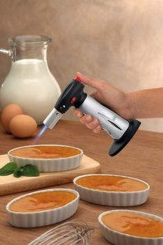 chef's torch  caramelizes sugar, browns meringue, handy for melting cheese or adding extra crisp