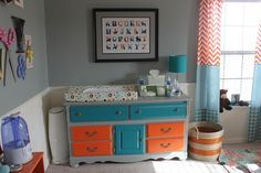 Customize your nursery with self-painted used furniture like this great dresser.  #nursery #orange #aqua