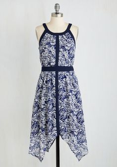 Your exhibition openings draw expansive audiences, so you flaunt this stunning midi to wow the crowd as much as your work does! Navy and ivory flowers adorn this handkerchief-hem dress as solid borders and panels pack a punch of structure to its flowing silhouette - reminiscent of your artistic integrity.