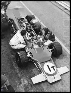 Graham Hill and his fantastic Lotus 63. The Lotus 63 was an experimental Formula One car, designed by Colin Chapman and Maurice Philippe for the 1969 season. Chapman's reasoning behind the car was that the 3-litre engines introduced in 1966 would be better served by building a car that could take full advantage of its power while retaining the Lotus 49's simplicity.