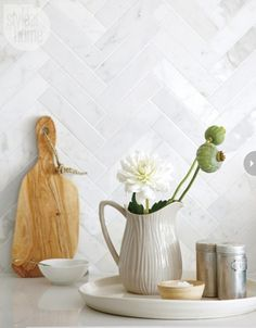 Maria: Will My White Kitchen be Cold? Pretty herringbone backsplash instead of subway tiles to add interest to the all white kitchen.Pretty herringbone backsplash instead of subway tiles to add interest to the all white kitchen. White Kitchen Backsplash, All White Kitchen, Kitchen Tiles, New Kitchen, Backsplash Ideas, Backsplash Tile, Splashback Ideas, Tile Ideas, Kitchen Design