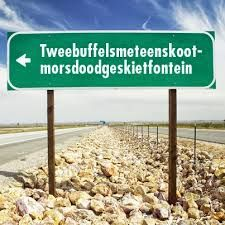 "Tweebuffelsmeteenskootmorsdoodgeskietfontein (44 letters) is a farm in the North West province of South Africa, located about 200 km west of Pretoria and 20 km east of Lichtenburg. Coordinates: 26°10′S 26°28′E whose 44-character name has entered South African folklore. The name was used as the title for an Afrikaans lyric written by Fanus Rautenbach (af) and performed by Anton Goosen.  Translation is ""The spring (lit. Fountain) where two buffaloes were cleanly killed with a single shot"""