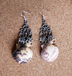 Tiger Shell Dangle Metal Earrings by JERIVANN on Etsy, $10.00 actually buying these as I type this, thanks.