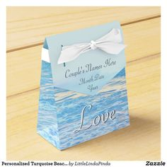 Personalized Turquoise Beach Wedding Favor Boxes with Couple's Names, Wedding Date and Love or Your Text or Delete. CLICK: https://www.zazzle.com/z/y80xi?rf=238147997806552929  Beautiful turquoise blue beach themed wedding favor boxes will add to your beach wedding decorations. Zazzle designer Linda can create matching beach themed wedding party supplies, decorations and gifts, personalized or not. Original photography by Little Linda Pinda Designs. CALL Linda at: 239-949-9090