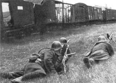 Romanian Infantry take cover behind a destroyed train