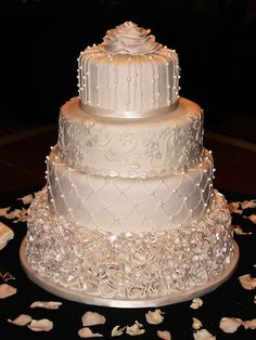 Classic Ivory Winter Wedding  cake with each tier having a different pattern, beautiful and would suit many wedding themes