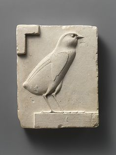 Ancient Egypt hieroglyph for W/U Relief plaque with quail chick