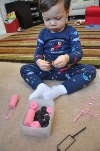 sponge curler threading - great for fine motor skills, and CHEAP!