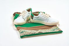 White canvas sneakers with traditional Peruvian textiles on the heel.
