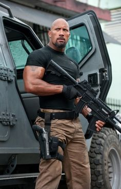 Dwayne Johnson alongside a Gurka LAPV in Fast Five