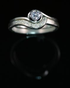And finally a sprinkling of grain set round brilliant cut diamonds are introduced to the wedding ring give the finished band a look of true elegance that will hug and compliment for it's lifetime.........