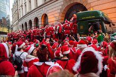 SantaCon revellers march through around Liverpool Street Station...