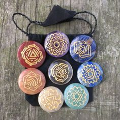 Grab this beautiful 8-stone set with engraved chakra symbols. | 16 Crystal Chakra Sets To Make You Feel Relaxed AF